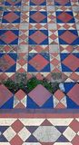 Traditional patterned pavement tiles. stock photo