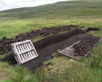 Traditional Peat Cutting. Blocks of peat which has been hand cut using traditional methods, on the Isle of Skye in Scotland Stock Photography