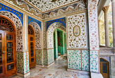 Traditional Persian design of the palace Golestan with painted walls, tiles and wooden doors Stock Photo