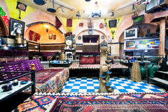 Traditional Persian tearoom with old carpets, vintage furniture and arts. ZANJAN, IRAN: Interior of historical Persian cafe house with old carpets, vintage Stock Photography