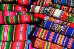 Traditional peruvian colorful textiles piled. In many markets in Peru, especially in the highlands you will find these colorful textiles for sale Stock Photography