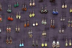Traditional peruvian earrings. Handmade traditional peruvian earrings sold at local market stock photos