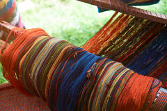 Traditional peruvian textile. Close-up on blurred background. Colorful woolen fabric stock images