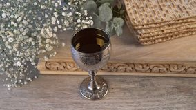 Pesach Passover symbols of great Jewish holiday. Traditional matzah and wine glass. stock footage