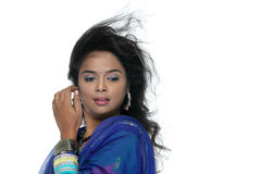Traditional petty Indian girl enjoying the wind Royalty Free Stock Images