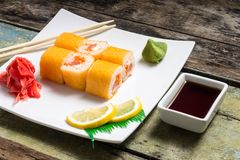 Traditional Philadelphia sushi rolls on white plate with chopstick Royalty Free Stock Images