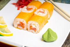 Traditional Philadelphia sushi rolls on white plate with chopstick Stock Photography