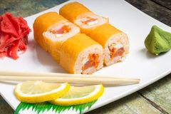 Traditional Philadelphia sushi rolls on white plate with chopstick Royalty Free Stock Photography