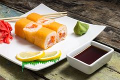 Traditional Philadelphia sushi rolls on white plate with chopstick Royalty Free Stock Photos