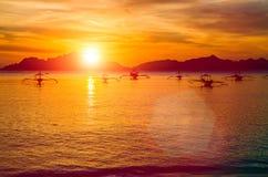 Traditional philippino boats at El Nido bay in sunset lights. Palawan island, Philippines Royalty Free Stock Images