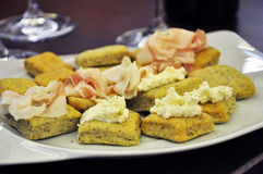 Traditional Piemonte appetizer: focaccia with fresh cheese and bacon Stock Photo
