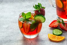 Traditional Pimms cocktail with lemonade, strawberries, cucumber. Orange and mint stock photography