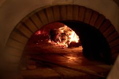 Traditional Pizza oven, burning wood and flames in fireplace Stock Image