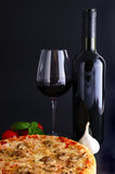 Traditional pizza and red wine Stock Photos