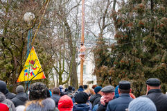 Traditional pole climb on the smooth wooden pole on Maslenitsa, people celebrate holiday in Moscow. Stock Image