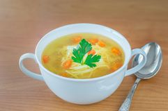 Traditional Polish chicken broth with carrot parsley. Royalty Free Stock Photo