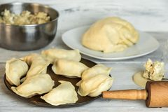 Traditional polish cuisine - delicious, homemade dumplings. Traditional polish cuisine - making delicious, homemade dumplings stock photography