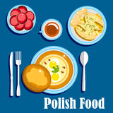 Traditional polish cuisine food and desserts. Traditional polish cuisine food with hard boiled eggs and bread bun, baked fish steaks, served with boiled new Royalty Free Stock Photos