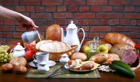 Traditional polish dinner. Fresh the bread-stuffs, hot coffe, the dairy produce Stock Photos
