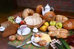 Traditional polish dinner. Fresh the bread-stuffs, hot coffe, the dairy produce Royalty Free Stock Photography