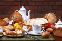 Traditional polish dinner. Fresh the bread-stuffs, hot coffe, the dairy produce Royalty Free Stock Photos