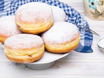 Traditional Polish donuts with powdered sugar on wooden background. Tasty doughnuts with jam Royalty Free Stock Image