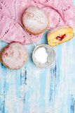 Traditional Polish donuts on wooden background. Tasty doughnuts with jam Stock Images