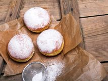 Traditional Polish donuts on wooden background. Tasty doughnuts with jam Royalty Free Stock Image