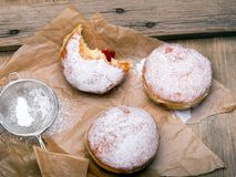 Traditional Polish donuts on wooden background. Tasty doughnuts with jam Stock Photo