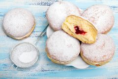 Traditional Polish donuts on wooden background. Tasty doughnuts with jam Stock Photography