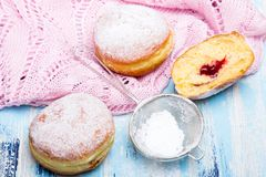 Traditional Polish donuts on wooden background. Tasty doughnuts with jam Royalty Free Stock Images