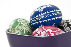 Traditional polish easter eggs in violet cup Royalty Free Stock Photos