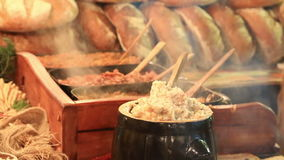 Traditional Polish food - Smalec at Christmas fair in Krakow stock footage