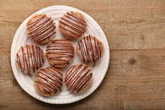 Traditional Polish homemade donuts with liqueur. Traditional Polish homemade donuts and empty space for text Stock Photo