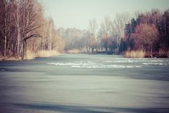 Traditional polish landscape in winter, frozen lake. Stock Image