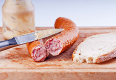 Traditional pork sausage  with bread Stock Images