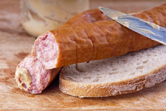 Pork sausage with bread and mustard Royalty Free Stock Photography