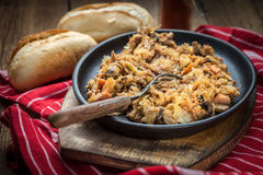 Traditional polish sauerkraut (bigos) with mushrooms and meat. Royalty Free Stock Photography