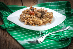 Traditional polish sauerkraut (bigos) with mushrooms and meat. Stock Photos