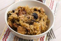 Traditional polish sauerkraut (bigos) with mushrooms and plums stock photo