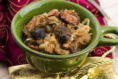 Traditional polish sauerkraut (bigos) with mushrooms and plums Royalty Free Stock Image