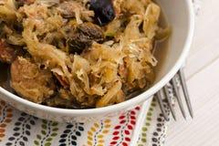 Traditional polish sauerkraut (bigos) with mushrooms and plums stock photography