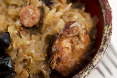 Traditional polish sauerkraut (bigos) with mushrooms and plums Stock Photography