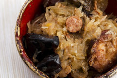 Traditional polish sauerkraut (bigos) with mushrooms and plums Royalty Free Stock Photography