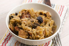 Traditional polish sauerkraut (bigos) with mushrooms and plums Royalty Free Stock Photo