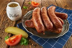 Traditional Polish sausage on an old plate, on old wooden boards stock images
