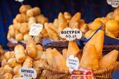 Traditional polish smoked cheese oscypek on outdoor market in Krakow, Poland. Royalty Free Stock Photography