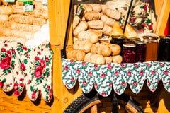Traditional polish smoked cheese oscypek on outdoor market in Zakopane Stock Photos
