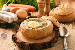 Traditional polish soup - zurek, served in bread loaf. Royalty Free Stock Photo