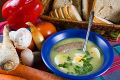 Traditional polish white borscht with eggs and sausage Stock Images